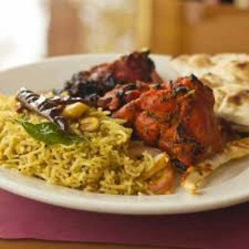 Tandoori Breast served on Pilaf Rice with a Cucumber Raita