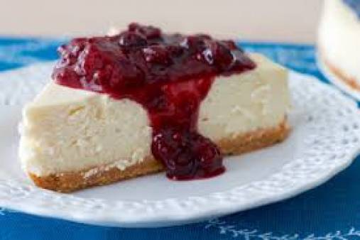 Wild berry cheesecake with berry sauce and cream